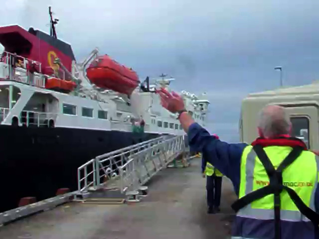 Roddy Mackay acknowledges the skipper and waves off the MV Clansman for the last time.
