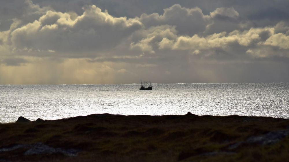Threatening clouds and silvery seas