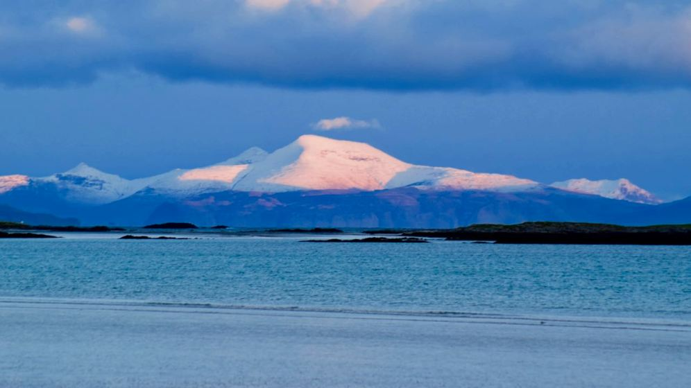Snow capped Ben More reflecting the setting sun