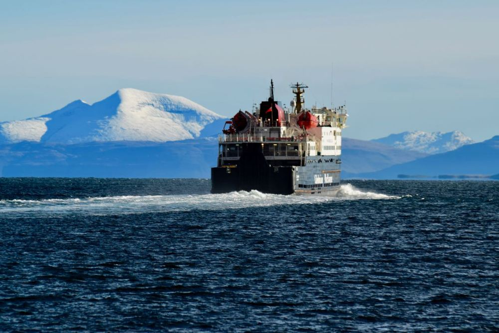 The MV Clansman heads out to sea - with a snow capped Ben More in the background