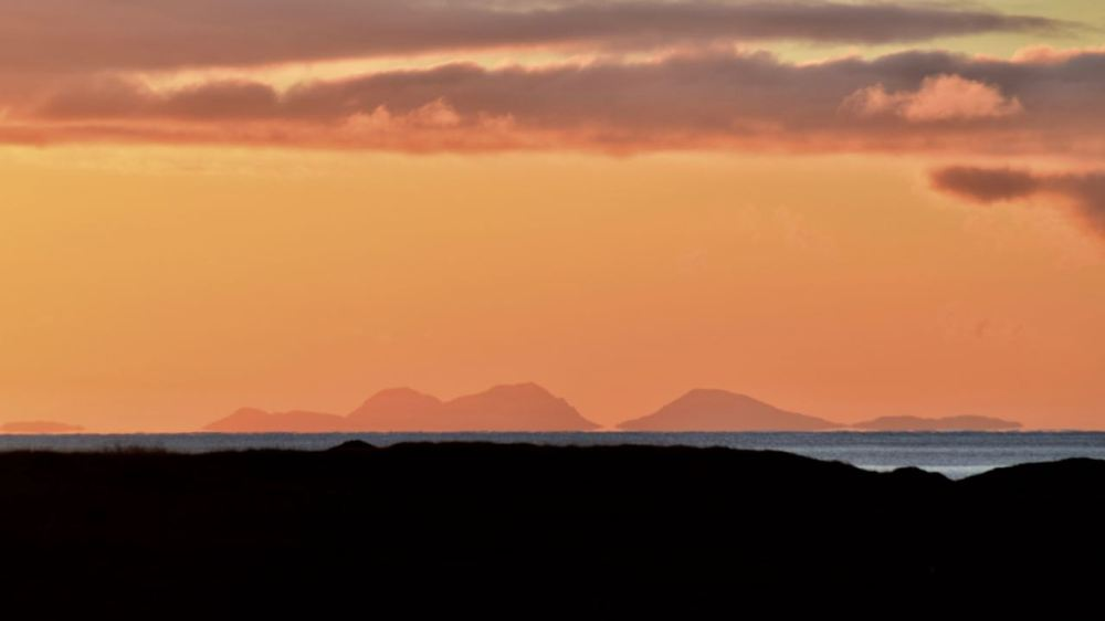Tuesday's sunrise and the view to the Paps of Jura