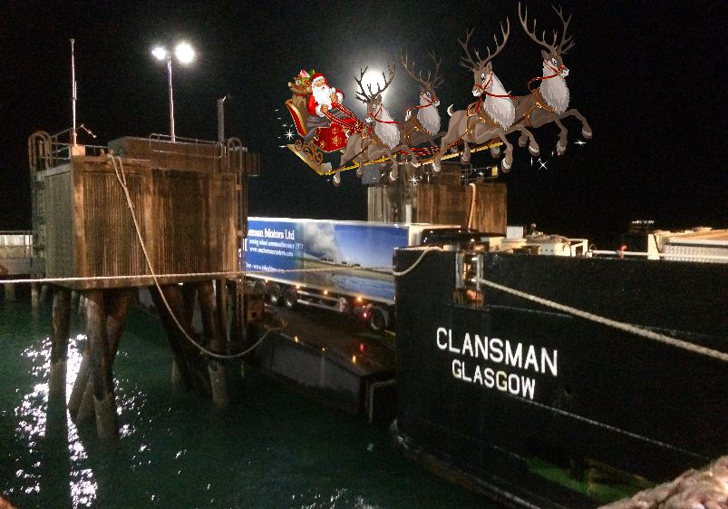Santa Claus flies past MacLennan's lorry coming off the Clansman