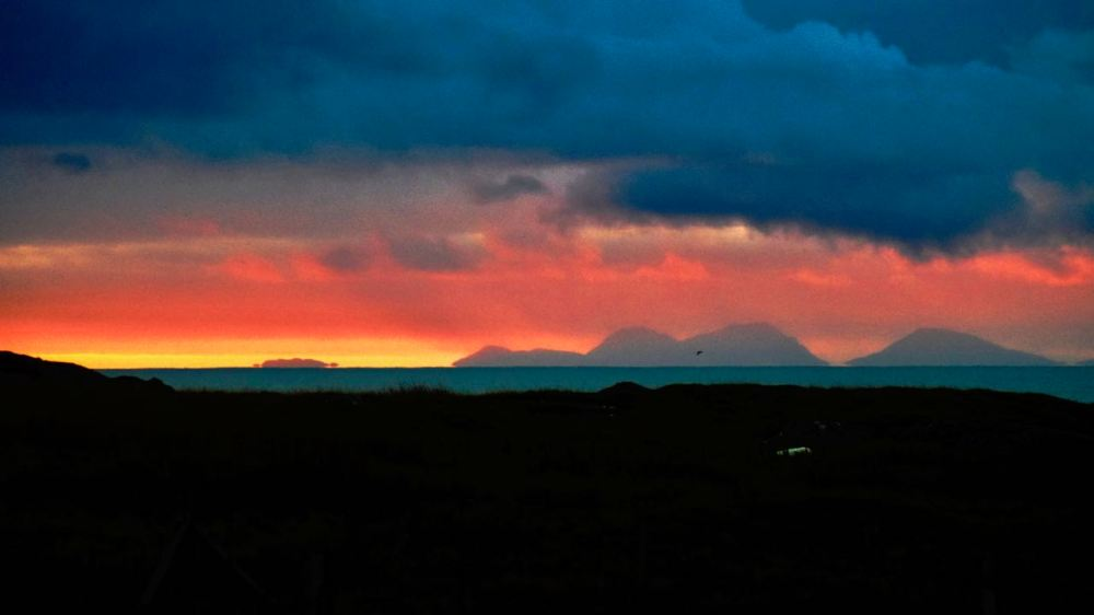 A fiery sky surrounding the Paps of Jura