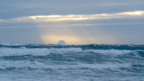 Wild waves away out to sea - even although they appear close .