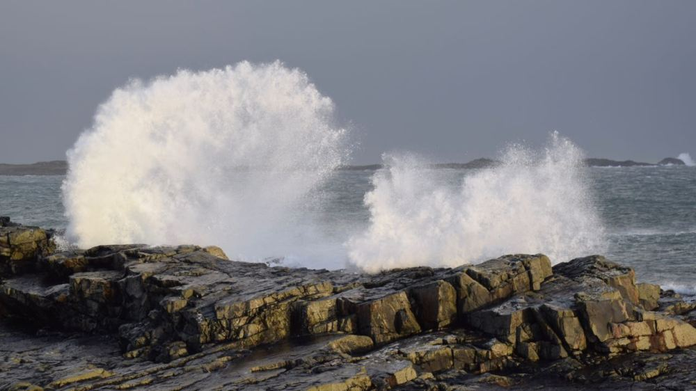 Powerful waves pound the rocks at Scarinish as a consequence of Storm Barbara