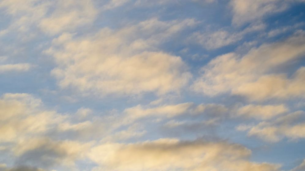 Clouds scurrying across a momentarily blue sky