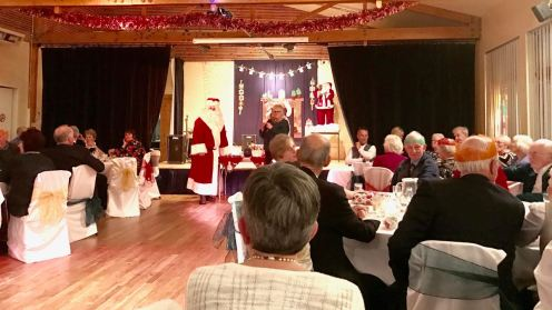 Santa Visits the party for 60+s