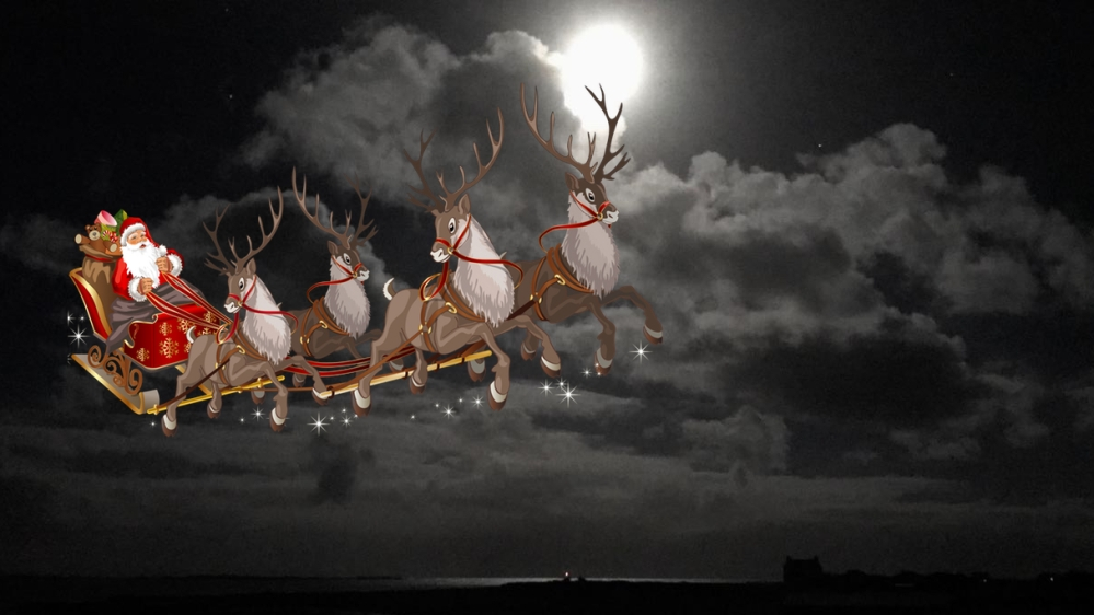 Santa captured on Camera over a moonlit Gott Bay