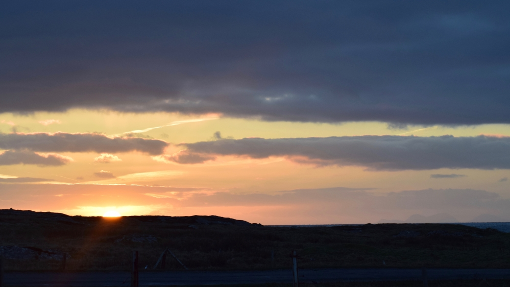 The sun rises above the Scarinish headland.