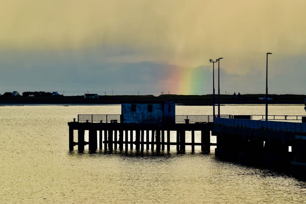 A rainbow from the pier, Gott Bay