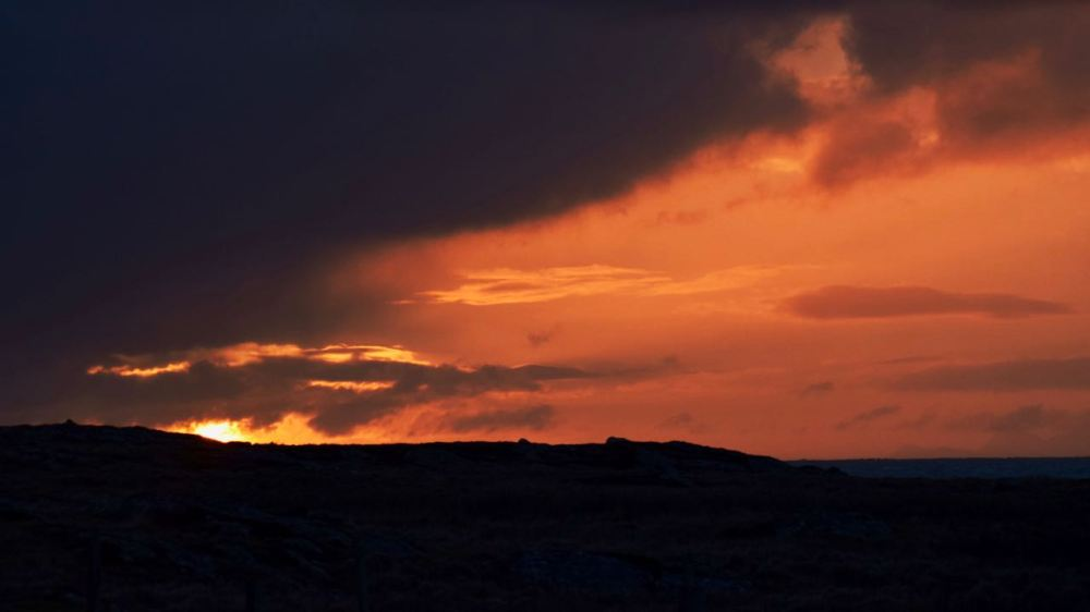 Sunrise over the Scarinish headland and Passage of Tiree
