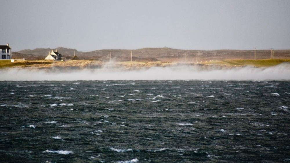 The North West wind producing spectacular spindrift in Gott Bay