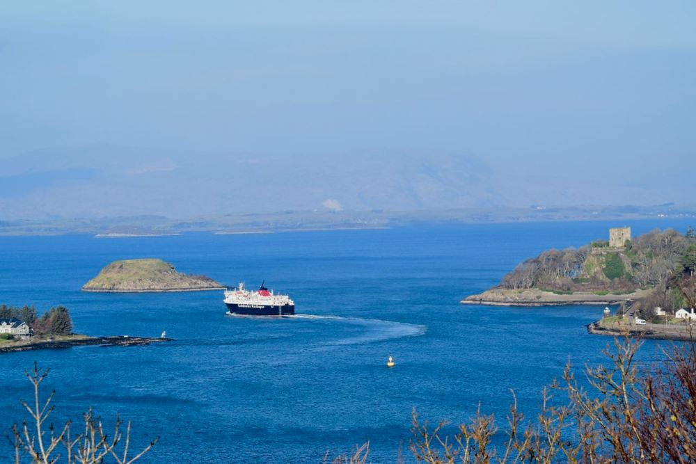 MV Isle of Mull passing Dunollie Castle as it heads out to sea