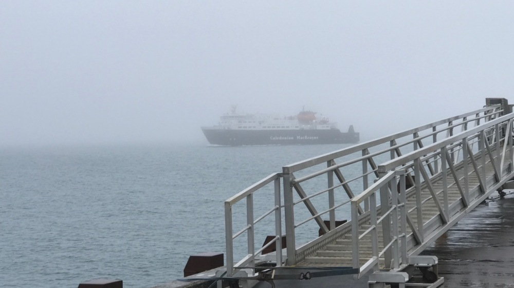 The Clansman appearing out of the fog shrouding Gott Bay