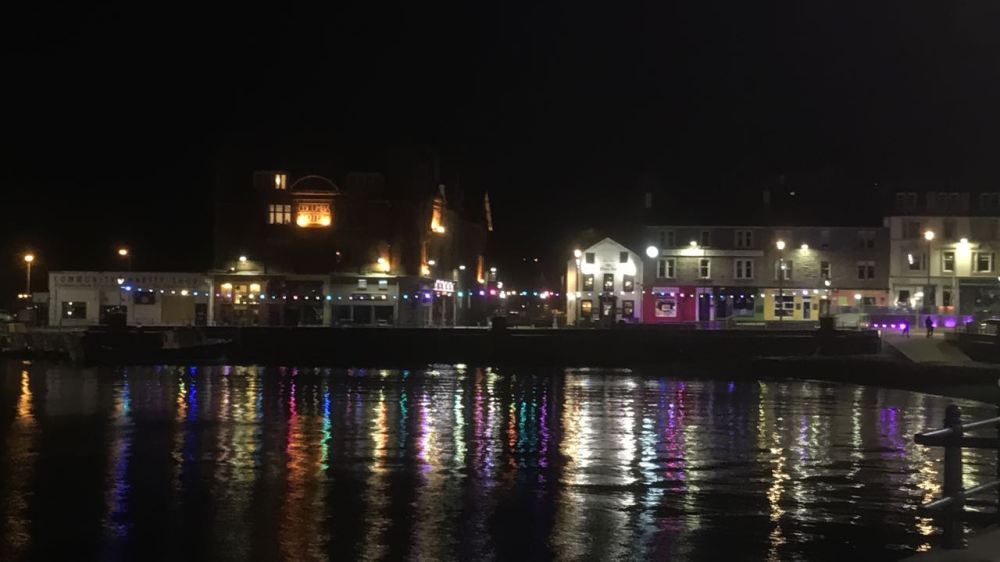 Floodlit Oban Front the night before we sailed