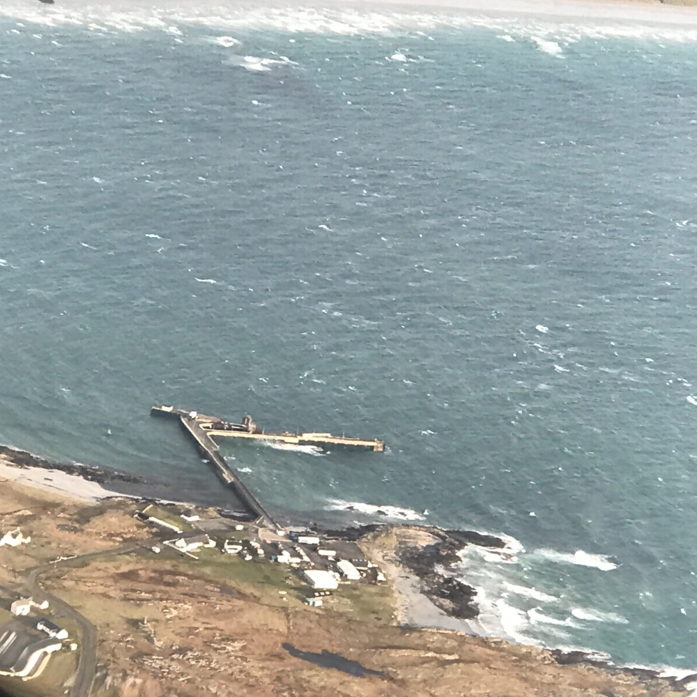 Tiree's pier from the air