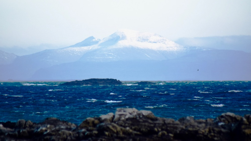The cold waters of the Passage of Tiree and Ben More - 20 miles distant.