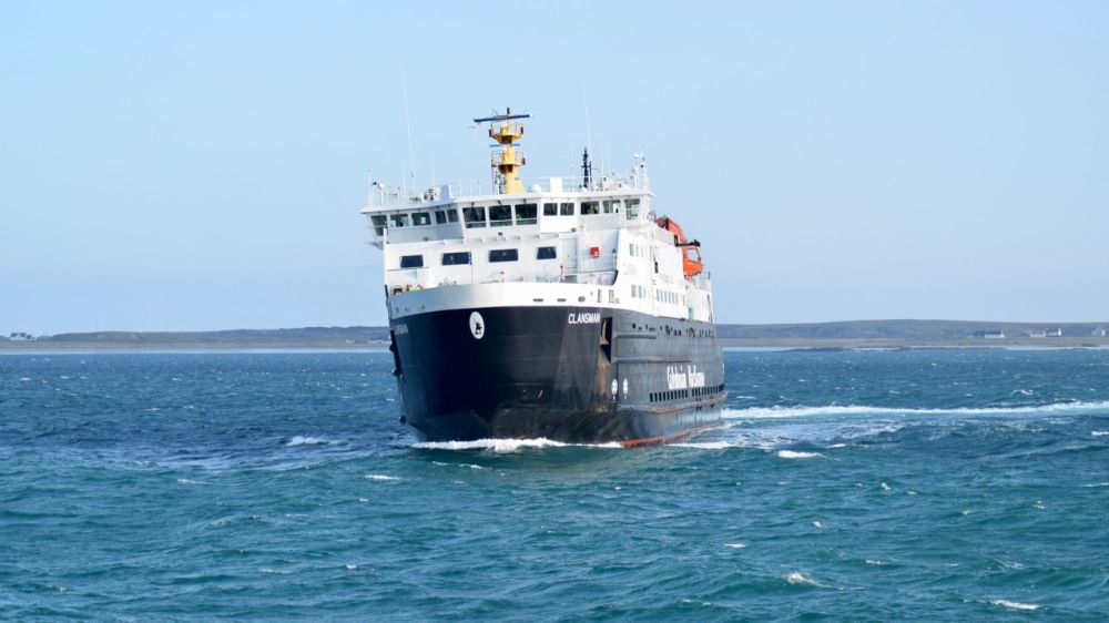 In the strong easterly the ferry cants as it swings to berth alongside the pier