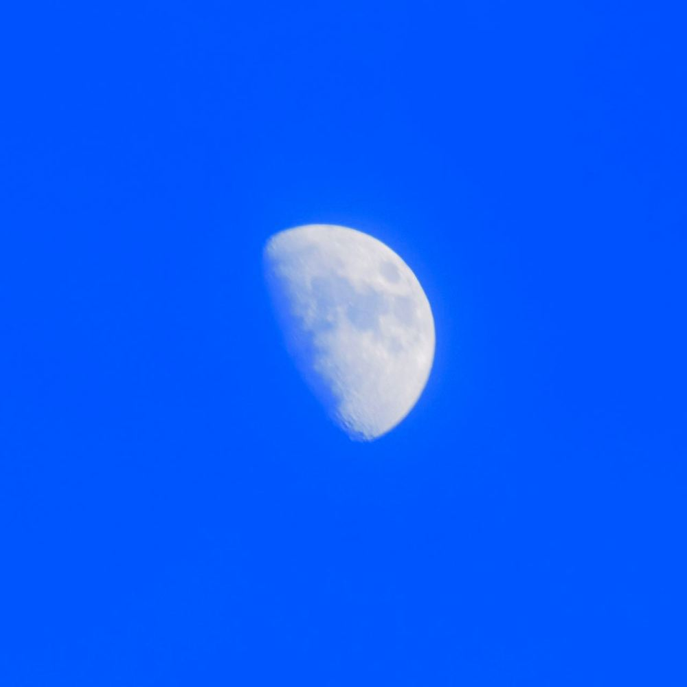 The moon waxing bright over Tiree at sundown