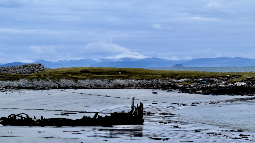 The view across Scarinish Harbour to Ben More on Mull