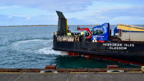 """The """"Heb Isles"""" bringing in her stern"""