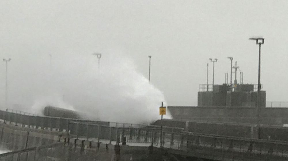 The waves breaking on the pier at the height of the storm