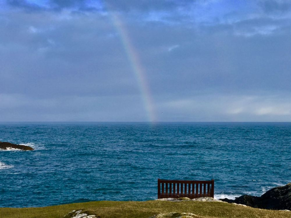 A rainbow lights up the Passage of Tiree later in the afternoon