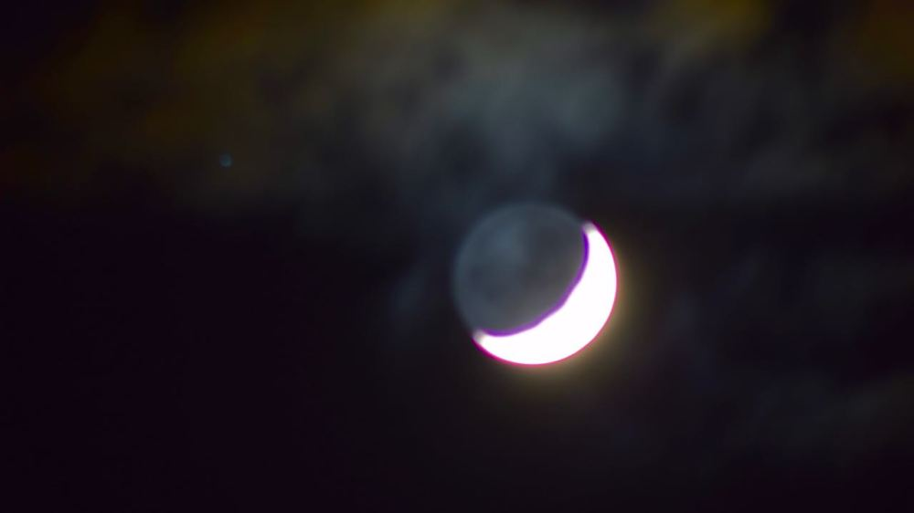 The New Moon with the Old Moon in its arms