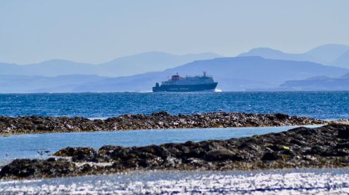 The Mv Clansman in the blue waters of the Passage of Tiree