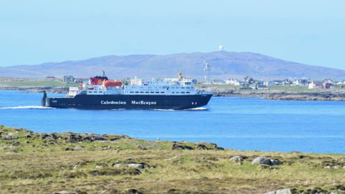 MV Clansman in the blue waters of Gott Bay
