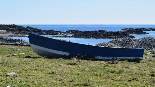 Blue boat, blue sea and sky - at West Hynish