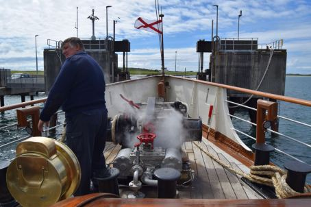 Steam hissing from the bow capstan