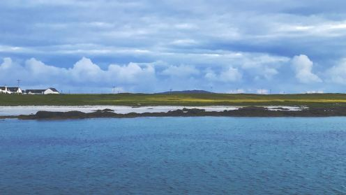 In the gloamin' the Machair stands out against impressive clouds