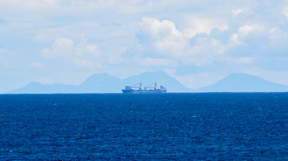The Paps of Jura and the cargo vessel SVENJA en route from Belfast to Denmark