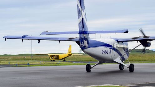 Islander for Coll/Oban and Twin Otter for Glasgow at Tiree Airport