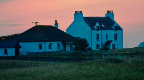 Glebe House and the Manse with the sky on Fire