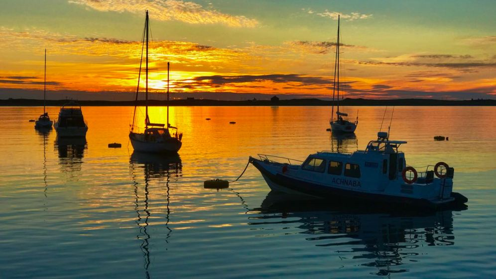 Sunset over the moorings in Gott Bay