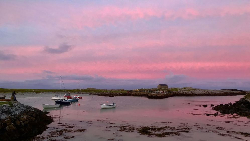 Sunset over the water at Scarinish Old Harbour