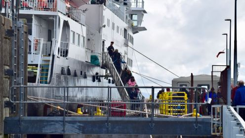 Foot passengers disembarking via the gangway.