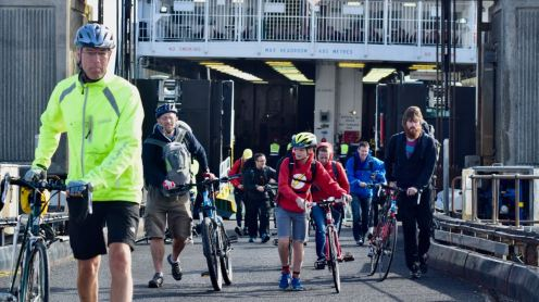 Cyclists disembarking via the ramp and link-span