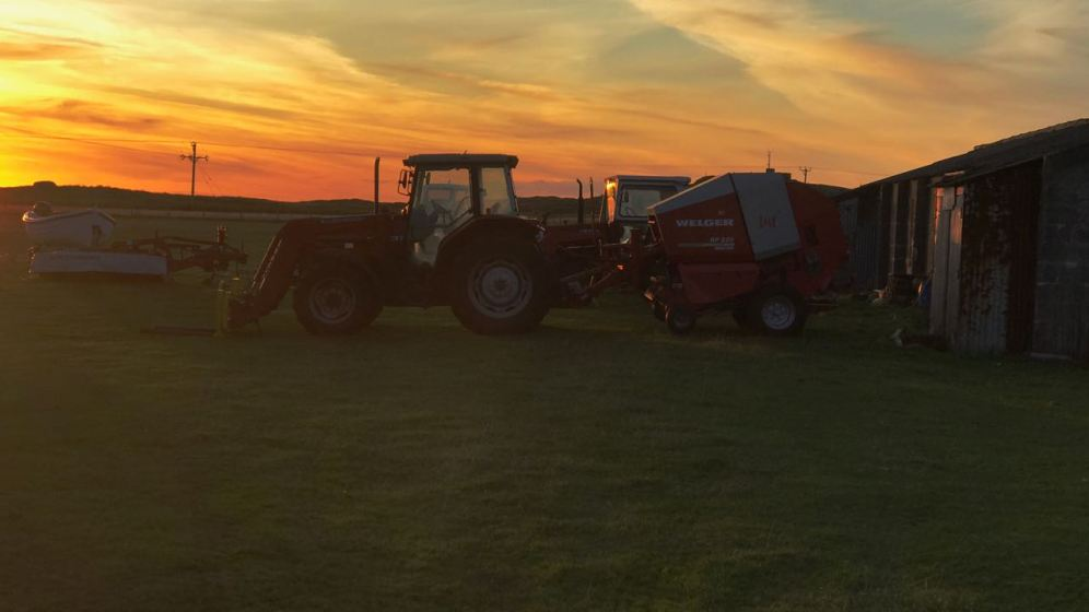 Tractor and baler at rest in Scarinish after a busy day
