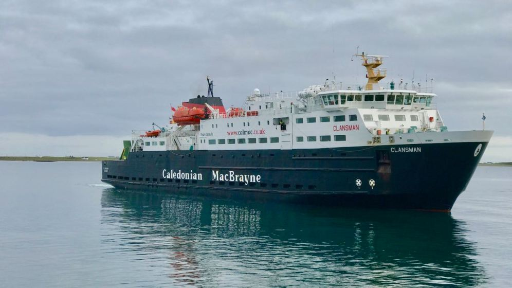 The MV Clansman mirrored by the pier