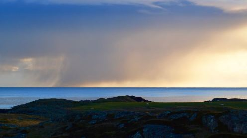 A snow shower to the south - out across the sea