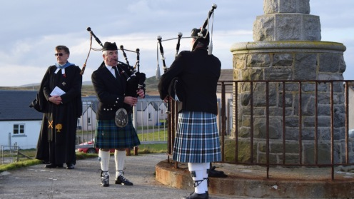 Two island pipers with a visiting Church of Scotland minister