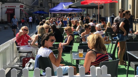 Diners enjoying the sunshine in Glasgow's Merchant City